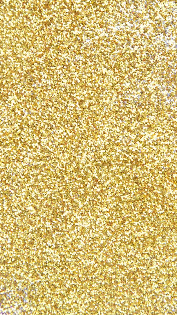 un tablero con brillos dorados